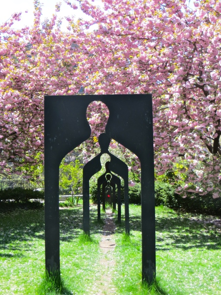 Art meets cherry trees on the grounds of St John's.